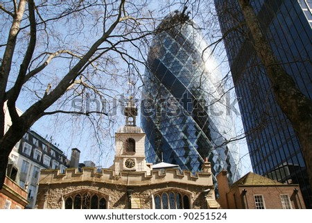 LONDON - APRIL 08: The modern glass buildings of the Swiss Re Gherkin on April 08, 2010 in London, England. This tower is 180 meters tall and stands near Liverpool Street Station in City of London. - stock photo