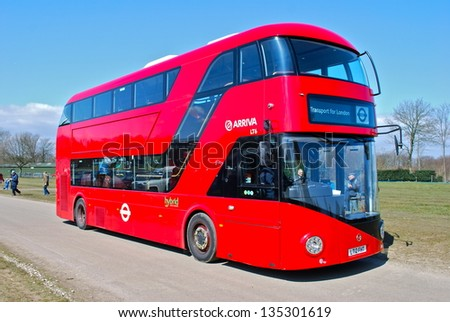 LONDON - APRIL 6: The much heralded hybrid 'New Bus For London' is now in service on route 38. It is 50% more fuel efficient than existing diesel buses. April 6, 2013 in London. - stock photo