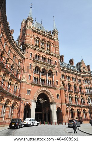 LONDON  APRIL 10. 2016. The restored south-east facade of the St Pancras Hotel and adjacent international railway station designed by Sir George Gilbert Scott and completed in 1868, London, UK. - stock photo