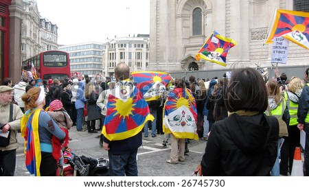 LONDON - APRIL 06 : Tibetan demonstration against China at Olympic torch relay run on April 06, 2008 in London, United Kingdom. Demonstrators were angered by Chinese oppression in Tibet.