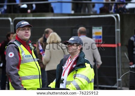 LONDON - APRIL 29 - Unidentified members of British Red Cross on call during the Royal Wedding of Prince William and Kate Middleton April 29, 2011 at Westminster Abbey in London, England. - stock photo
