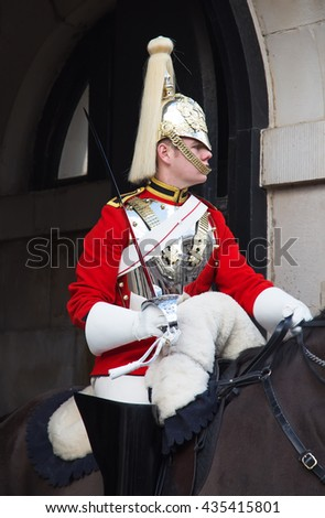 LONDON - APRIL 16: Unidentified men members of the royal guard nearby Whitehall palace on April 16, 2016 in London, United Kingdom. - stock photo