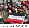 LONDON- APRIL 2: Unidentified Yemen supporters protest for freedom and democracy to be restored in there country on April 2, 2011 outside Downing Street in London, England. - stock photo
