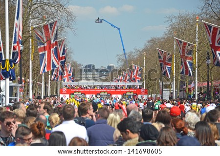 LONDON, APRIL 21: View down the Mall to the finishing line of the London Marathon in London, UK on April 21, 2013. Run annually, the race is in the top five of international world marathons. - stock photo