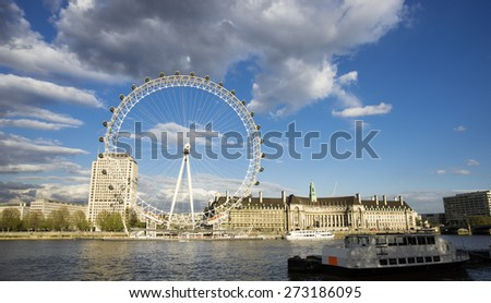 LONDON - APRIL 27 : View of The London Eye on April 27, 2015 in London, England. A famous tourist attraction at a height of 135 metres (443 ft) and the biggest Ferris wheel in Europe.  - stock photo