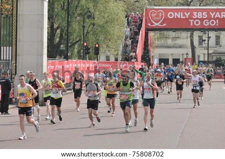 LONDON - APRIL 17: Virgin London Marathon 2011. London, UK. 17/04/2011. Unidentified runners - stock photo