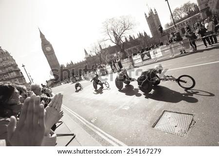 LONDON - APRIL 13: Wheelchair racing contestants in London Marathon. The London Marathon is next to New York, Berlin, Chicago and Boston to the World Marathon Majorson on April 13, 2012, London, UK.  - stock photo