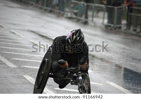 LONDON - APRIL 25: Wheelchair racing contestants in the London Marathon on April, 25, 2010 in London, UK. London Marathon is next to New York, Berlin, Chicago and Boston to the World Marathon Majors - stock photo