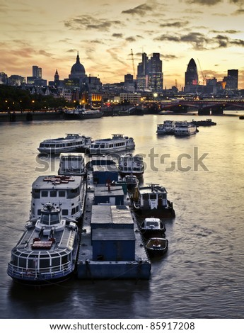London at dawn. St Paul's Cathedral and financial district, Tower 42, Blackfriars Bridge - stock photo