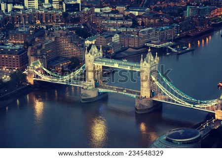 London at night with urban architectures and Tower Bridge - stock photo
