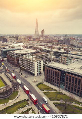 London At Sunset, yellow sun light over London City Center - View on business modern district  - stock photo
