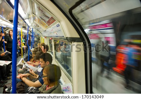 LONDON - AUG 6: An interior view of London subway on Aug. 6, 2012 in London, UK. London's system is the oldest underground railway in the world, dating back to 1863. - stock photo