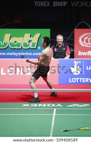 LONDON AUG 14: China's Lin Dan celebrates after winning the men's singles final against Malaysia's Lee Chong Wei at the World Badminton Championships at Wembley Arena, London August 14, 2011. - stock photo