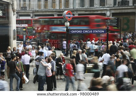 LONDON - AUG 2 : Crowd passing oxford circus on Aug 2, 2010, London, UK. Oxford Circus, busy intersection with Regent Street, is the biggest shopping street in Europe, visited by millions of tourists - stock photo