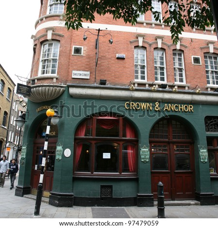LONDON - AUG 16: Exterior of pub, for drinking and socializing, focal point of the community, on Aug 16, 2010, London, UK. Pub business, now about 53,500 pubs in the UK, has been declining every year - stock photo