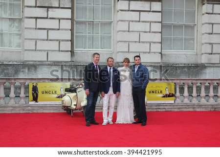 LONDON - AUG 7, 2015: (L-R) Lionel Wigram, Guy Ritchie, Jacqui Ainsley and Henry Cavill attend The Man from U.N.C.L.E. - UK film premiere at Somerset House on Aug 7, 2015 in London - stock photo