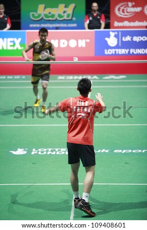LONDON AUG 14: Lee Chong Wei (L) of Malaysia plays China's Lin Dan at the men's singles final match of the World Badminton Championships at Wembley Arena in London on August 14, 2011. Lin Dan won 2-1. - stock photo