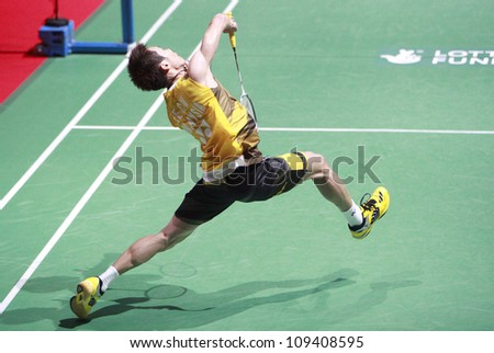 LONDON AUG 14: Lee Chong Wei of Malaysia plays a shot during the men's singles final against China's Lin Dan at the World Badminton Championships at Wembley Arena in London on August 14, 2011. - stock photo