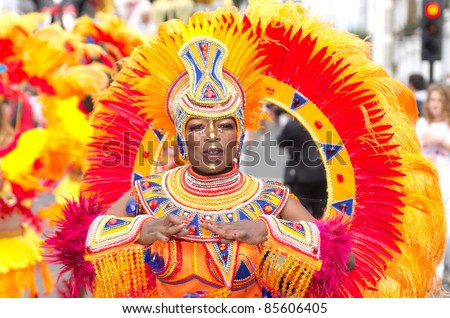 """LONDON - AUG 29: member of """"paraiso"""" school of samba parades at the Notting Hill Carnival on August 29, 2011 in London, England. The annual carnival  takes place every Bank Holiday since 1966. - stock photo"""