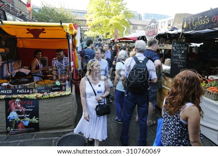 LONDON - AUG 22 : Street Foods Stall in Camden Market, famous tourist attractions in Camden Town, on Aug 22, 2015, London, UK. The Market attracting about 100,000 visitors each weekend. - stock photo