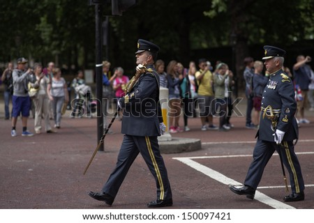 LONDON - AUG 12 : The changing of the guard ceremony at Buckingham Palace on August 12th, 2013 in London, UK. On this occasion, the Royal Air Force soldiers were part of the parade. - stock photo