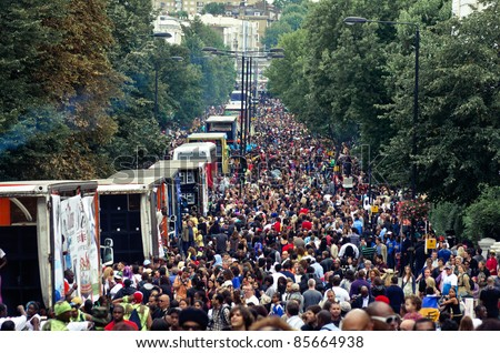 LONDON - AUG 28: view of  ladbroke Grove street full during the  Notting Hill Carnival on August 29, 2011 in London, England. - stock photo