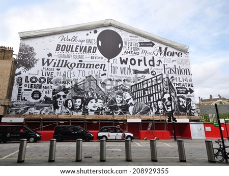LONDON - AUGUST 2. A giant mural on August 2, 2014 by artist Gregori Saavedra wrapping the 1865 German Gymnasium now under transformation to a complex of restaurants and bars at King's Cross, London.