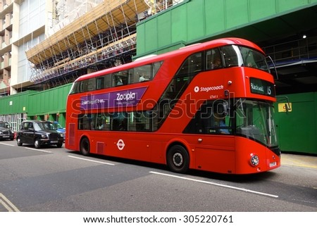 LONDON - AUGUST 11: A London bus at Cannon Street, London. London buses are increasingly fuel efficient. August 11, 2015 in London. - stock photo