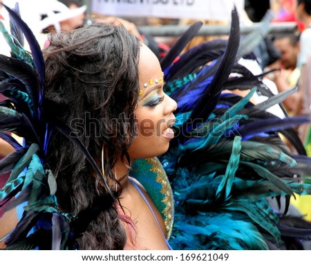 LONDON - AUGUST 27: A performer takes part in the third day of the Notting Hill Carnival, the largest in Europe, on August 27, 2012 in London, UK. Carnival takes place over three days in every August. - stock photo