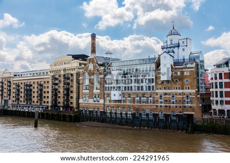 LONDON -AUGUST 6:  Butler's Wharf building on August 6, 2014 in London. Butler's Wharf was built between 1871-73 as a shipping wharf and warehouse and contained the largest tea warehouse in the world. - stock photo