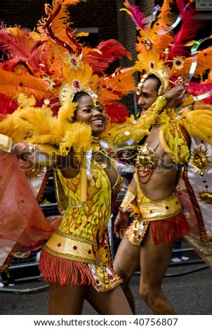 LONDON - AUGUST 31: Dancers from the Paraiso School of Samba float during the Notting Hill Carnival August 31, 2009 in London, England. - stock photo