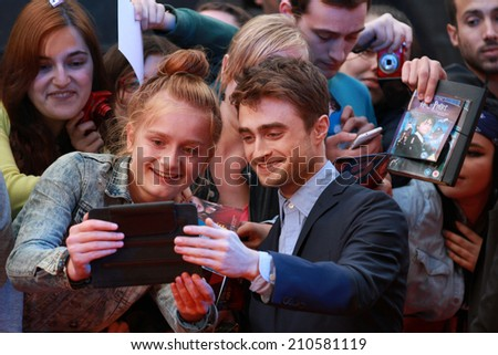 LONDON - AUGUST 12: Daniel Radcliffe attends the UK Premiere of What if at the Odeon West End on August 12, 2014 in London - stock photo