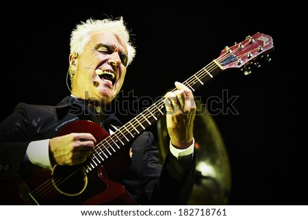LONDON - AUGUST 27: David Byrne and St Vincent performs at Roundhouse Camden on August 27, 2013 in London. - stock photo