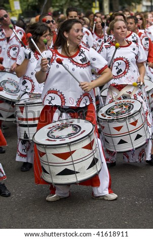 LONDON - AUGUST 31: Drummers from Batala Banda de Percussao playing drums at the Notting Hill Carnival on August 31, 2009 in London, England. - stock photo