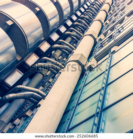 LONDON -AUGUST 6:  Exterior details of Lloyds Building on August 6, 2014 in London. The building is a leading example of Bowellism architecture.  - stock photo