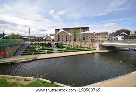 LONDON - AUGUST 4. Granary Square is a new regeneration development, terraced down to the Regent's Canal with graphics coordinating the surrounding historic buildings; August 4, 2013, in London, UK. - stock photo