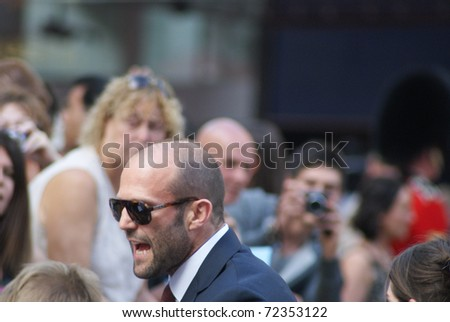 LONDON - AUGUST 9: Jason Statham greets fans as he arrives at the UK Premiere of 'The Expendables' in Leicester Square on August 9, 2010 in London