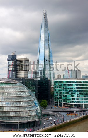LONDON -AUGUST 6: London Skyline with City Hall, Shard, River Thames on August 6, 2014 in London .The Shard (London Bridge), is the tallest building in Europe, standing approximately 306 meters.  - stock photo