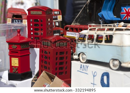 LONDON - August 9: Market in Portobello road on August 9, 2014 in London,United Kingdom.Portobello market is one of the most street markets in the world;it's located in Portobello road in Notting Hill - stock photo