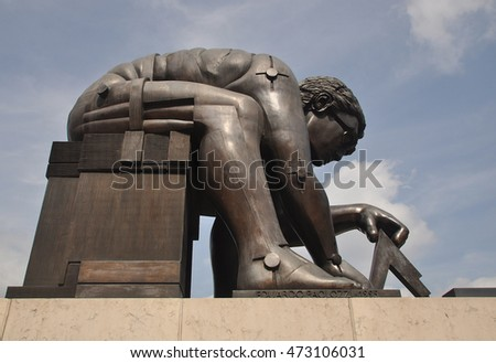 LONDON - AUGUST 16, 2016. 'Newton' is a 1995 bronze sculpture by Eduardo Paolozzi, after a painting of Issac Newton by William Blake, located on the British Library concourse in London, UK.