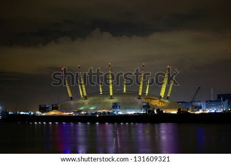LONDON - AUGUST 6: Night illumination of Millennium Dome, also called O2 Arena, in the distance across the river Thames during the Olympic Games time in London, August 6, 2012. - stock photo