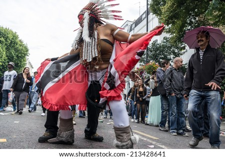 LONDON - AUGUST 24: Performers take part in the First day of Notting Hill Carnival, August 24, 2014 in London, UK.