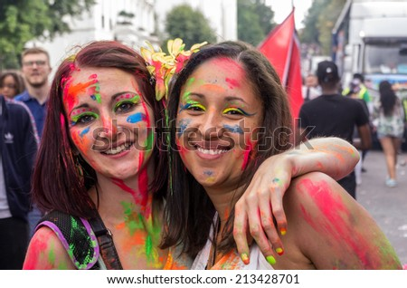 LONDON - AUGUST 24: Performers take part in the First day of Notting Hill Carnival, August 24, 2014 in London, UK. - stock photo