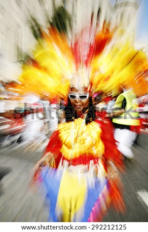 LONDON - AUGUST 26: Performers take part in the first day of Notting Hill Carnival, largest in Europe, on August 26, 2012 in London, UK. Carnival takes place over two days in every August. - stock photo