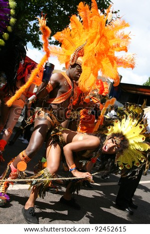 LONDON - AUGUST 30: Performers take part in the second day of Notting Hill Carnival, largest in Europe, on August 30, 2010 in London, UK. Carnival takes place over two days in every August.