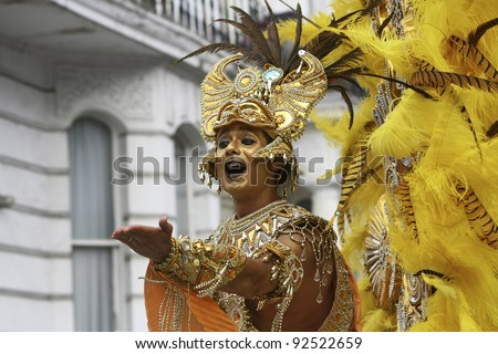 LONDON - AUGUST 31: Performers take part in the second day of Notting Hill Carnival, largest in Europe, on August 31, 2009 in London, UK. Carnival takes place over two days in every August. - stock photo