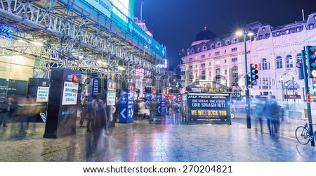 LONDON - AUGUST 22, 2013: Regent Street at night. It was named after Prince Regent, completed in 1825. Every building in Regent Street is protected as a Listed Building - stock photo
