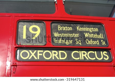 LONDON - AUGUST 10: Routemaster Bus on route 19 operating in London on August 10, 2015 in London, UK. The open platform facilitated speedy boarding under the supervision of a conductor.  - stock photo