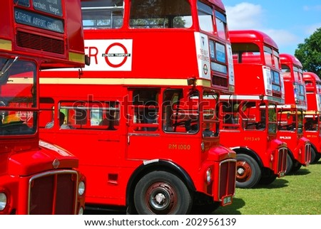LONDON - AUGUST 10: Routemaster Bus operating in London on August 10, 2011 in London, UK. The open platform facilitated speedy boarding under the supervision of a conductor. - stock photo