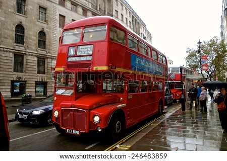 LONDON - AUGUST 10: Routemaster Bus operating in London on August 10, 2011 in London, UK. The open platform facilitated speedy boarding under the supervision of a conductor. August 10, 2014 in London. - stock photo